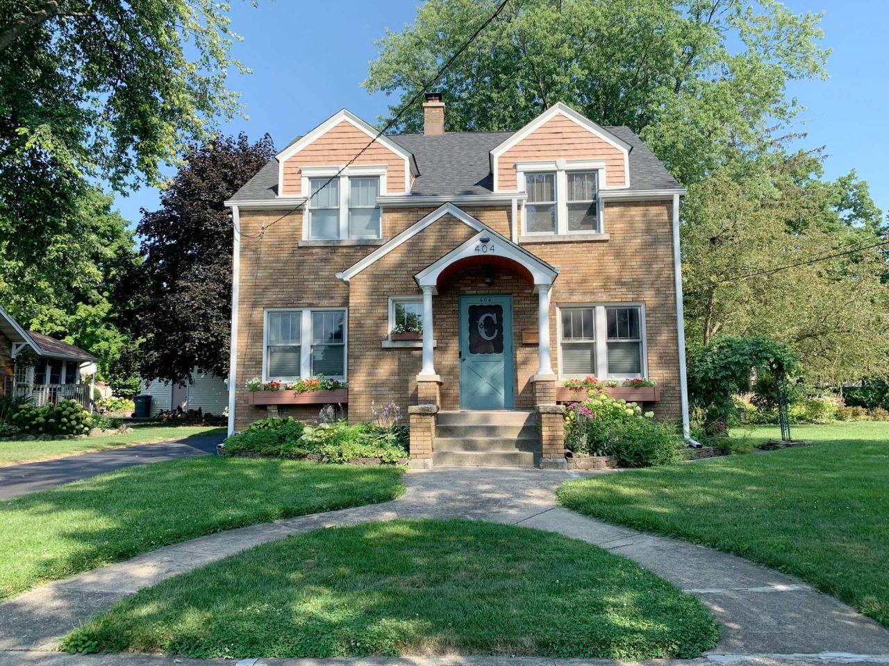 Lockport Illinois Home with Colored Door and Window boxes